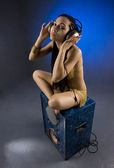 The girl with headphones on a dark blue background — Стоковое фото