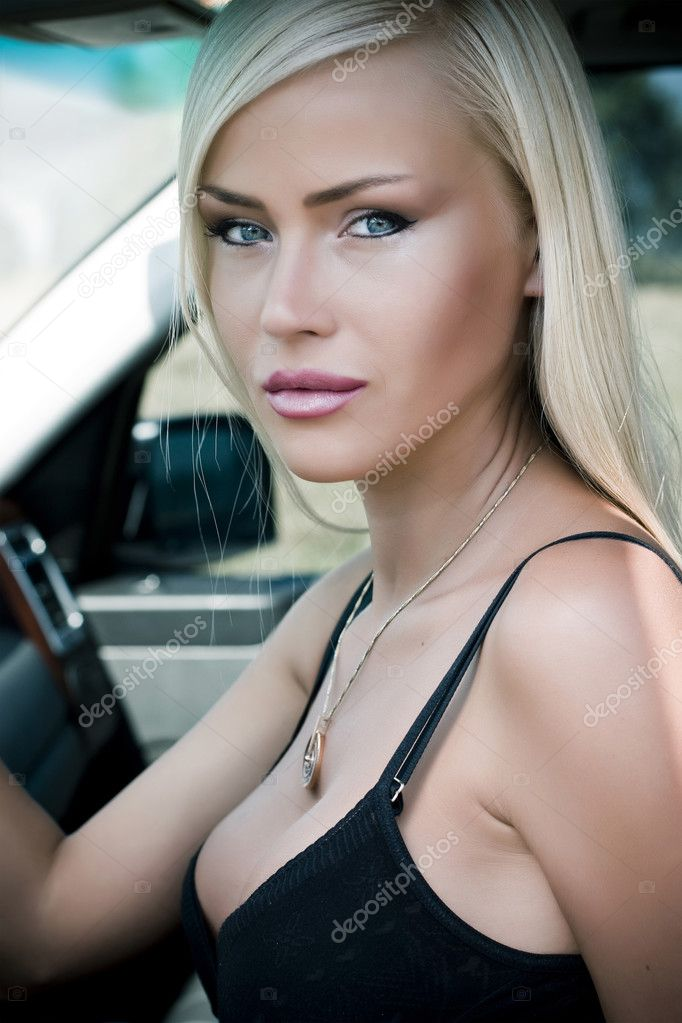 Portrait of a sexy woman in  car — Stock Photo #3726534