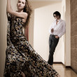 Stock Photo: Young pair, the girl in a beautiful dress and the guy in an interior