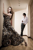 Young pair, the girl in a beautiful dress and the guy in an interior — Stock Photo