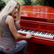 Woman playing the piano — Stock Photo