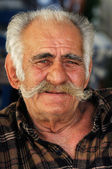 Senior Greek man with a big mustache — Stock Photo
