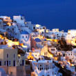 The village of Oia at dusk - Stock Photo