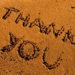 Thank you message on sand - Stock Photo