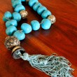 Old chaplet with turquoise beads - Stock Photo