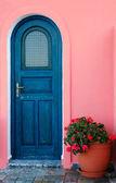 Blue door on a Greek island — Stock Photo