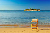 Chair on sandy beach — Stock Photo