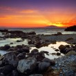 Glorious sunset over rocky sea — Stock Photo