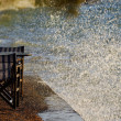Tables and waves splash — Stock Photo