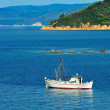 Stock Photo: Fishing trawler among Greek islands