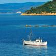 Fishing trawler among Greek islands — Stock Photo