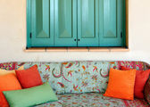 Sofa in the porch of a Greek island house — Stock Photo