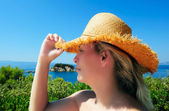 Young attractive woman in straw hat during holidays in the Medit — Stock Photo