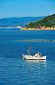 Fishing trawler among Greek islands — Stock Photo
