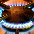 Old gas cooker hob in operation - Stock Photo