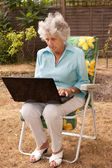 Mature Lady Working On A Laptop — Stock Photo