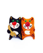 Whistle in the form of toys in the form of two cats with a fish — Stock Photo