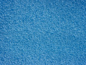 Background with blue foamed polyethylene. — Stock Photo