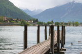 Planked footway on mountain lake in Swiss — Stock Photo