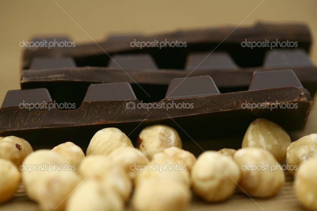 Enjoy chocolate with almonds and hazelnut blended image — Stock Photo #3718343