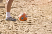 Foot player in beach soccer — Stockfoto