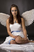 Pretty young angel in white cloth — Stock Photo