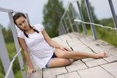 Young woman on the bridge — Стоковое фото