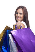 Pretty young woman with bags of purchases — Stock Photo