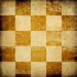 Grungy chessboard stained background. — Stock Photo