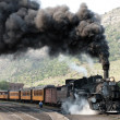 Departure of an old steam locomotive - Stock Photo