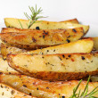 Royalty-Free Stock Photo: Roasted potatoes vertical