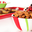 Shot of holiday almonds & cranberries with cookies - Stock Photo