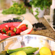 Fruits & veggies on counter — Stock Photo