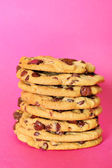 Chocolate chip cookie stack on pink vertical — Stock Photo