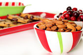 Shot of holiday almonds & cranberries with cookies — Stock Photo