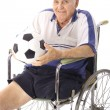 Handicap elderly man with soccer ball vertical — Stock Photo