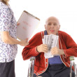 Elderly man paying healthcare bills — Stock Photo #3469224