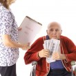 Elderly handicap senior paying medical bill — Stock Photo