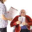 Elderly handicap senior paying medical bill - Stock Photo
