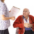 Elderly patient talking to nurse — Stockfoto #3469229