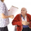 Stock Photo: Elderly patient talking to nurse