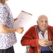 Stock Photo: Nurse checking elderly patient isolated on white