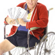 Handicap man with lots of money — Stock Photo #3469237