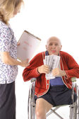 Elderly man paying healthcare bills — Stock Photo