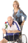 Shot of a handicap elderly man with younger woman — Foto Stock