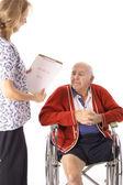 Nurse holding medical bill — Stock Photo