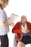 Elderly patient talking to nurse — Stock Photo