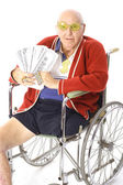Handicap man with lots of money — Stock Photo