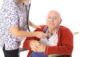 Nurse checking elderly mans pulse isolated on white — Stock Photo