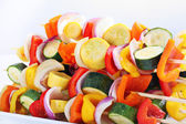 Vegetables on skewers to be grilled — Stock Photo
